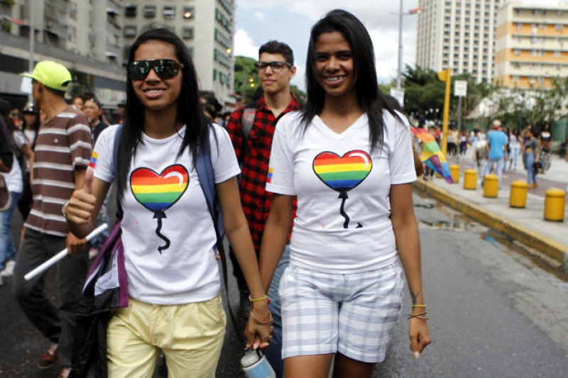 LGBTI activists march through Caracas in their annual pride event